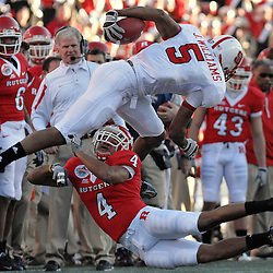 Dec. 29, 2008; Birmingham, AL, USA; Rutgers cornerback David Rowe (4) submarines North Carolina State wide receiver Jarvis Williams (5) during the second quarter of the Rutgers Scarlet Knights' victory over the N.C. State Wolfpack 29-23 in the Papajohns.com Bowl at Legion Field.