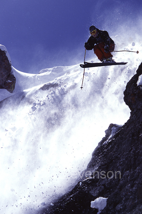 A man jumping while skiing at Squaw Valley, CA.