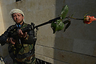 "Aleppo, Syria, January, 2013.- ""The Saura""--revolution--""is a flower,"" said  ABU- YOUSSEF, a former trader who is now member of the Baslaier Al -Nasr unit, Battalion 80, of the rebel Free Syrian Army. He is stationed in a mental hospital in the town of Aldoreneh which is abandoned after being bombed by the Syrian Army. (Photo by Miguel Juárez Lugo)"