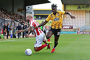 Jordan Forster and Ada Azeez  during the EFL Sky Bet League 2 match between Cambridge United and Cheltenham Town at the Cambs Glass Stadium, Cambridge, England on 25 August 2018.