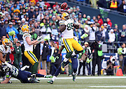 Green Bay Packers tight end Brandon Bostick (86) leaps and tries unsuccessfully to catch an onside kick while Green Bay Packers wide receiver Jordy Nelson (87) looks to catch the loose ball recovered by the Seahawks and giving them the ball at the 50 yard line with just over two minutes left on the fourth quarter clock during the NFL week 20 NFC Championship football game against the Green Bay Packers on Sunday, Jan. 18, 2015 in Seattle. The Seahawks won the game 28-22 in overtime. ©Paul Anthony Spinelli
