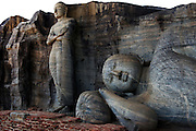 These two giant statues of Buddha in different states of contemplation have inspired pilgrims since being carved into the granite in the 12th century, Gal Vihara, Polonnaruwa, Sri Lanka