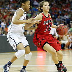 Apr 9, 2013; New Orleans, LA, USA; Louisville Cardinals guard Jude Schimmel (22) dribbles against Connecticut Huskies guard Moriah Jefferson (left) during the second half of the championship game in the 2013 NCAA womens Final Four at the New Orleans Arena. Mandatory Credit: Derick E. Hingle-USA TODAY Sports