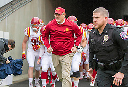 Nov 28, 2015; Morgantown, WV, USA; Iowa State Cyclones head coach Paul Rhoads leads his team out on the field prior to their game against the West Virginia Mountaineers at Milan Puskar Stadium. Mandatory Credit: Ben Queen-USA TODAY Sports