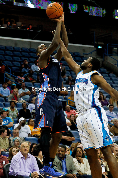 October 9, 2012; New Orleans, LA, USA; Charlotte Bobcats forward Michael Kidd-Gilchrist (14) shoots over New Orleans Hornets forward Darius Miller (2) during the fourth quarter of a preseason game at the New Orleans Arena. The Hornets defeated the Bobcats 97-82.  Mandatory Credit: Derick E. Hingle-US PRESSWIRE