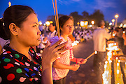 "30 JANUARY 2013 - PHNOM PENH, CAMBODIA:    Cambodian women pray for late Cambodian King Norodom Sihanouk in Phnom Penh. Sihanouk (31 October 1922 - 15 October 2012) was the King of Cambodia from 1941 to 1955 and again from 1993 to 2004. He was the effective ruler of Cambodia from 1953 to 1970. After his second abdication in 2004, he was given the honorific of ""The King-Father of Cambodia."" Sihanouk held so many positions since 1941 that the Guinness Book of World Records identifies him as the politician who has served the world's greatest variety of political offices. These included two terms as king, two as sovereign prince, one as president, two as prime minister, as well as numerous positions as leader of various governments-in-exile. He served as puppet head of state for the Khmer Rouge government in 1975-1976. Most of these positions were only honorific, including the last position as constitutional king of Cambodia. Sihanouk's actual period of effective rule over Cambodia was from 9 November 1953, when Cambodia gained its independence from France, until 18 March 1970, when General Lon Nol and the National Assembly deposed him. Upon his final abdication, the Cambodian throne council appointed Norodom Sihamoni, one of Sihanouk's sons, as the new king. Sihanouk died in Beijing, China, where he was receiving medical care, on Oct. 15, 2012. His cremation is scheduled to take place on Feb. 4, 2013. Over a million people are expected to attend the service.        PHOTO BY JACK KURTZ"