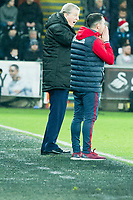 Football - 2017 / 2018 Premier League - Swansea City vs. Crystal Palace<br /> <br /> Crystal PalaceRoy Hodgson manager & Swansea City acting manager Leon Britton shout to their teams on the touchline, at the Liberty Stadium.<br /> <br /> COLORSPORT/WINSTON BYNORTH