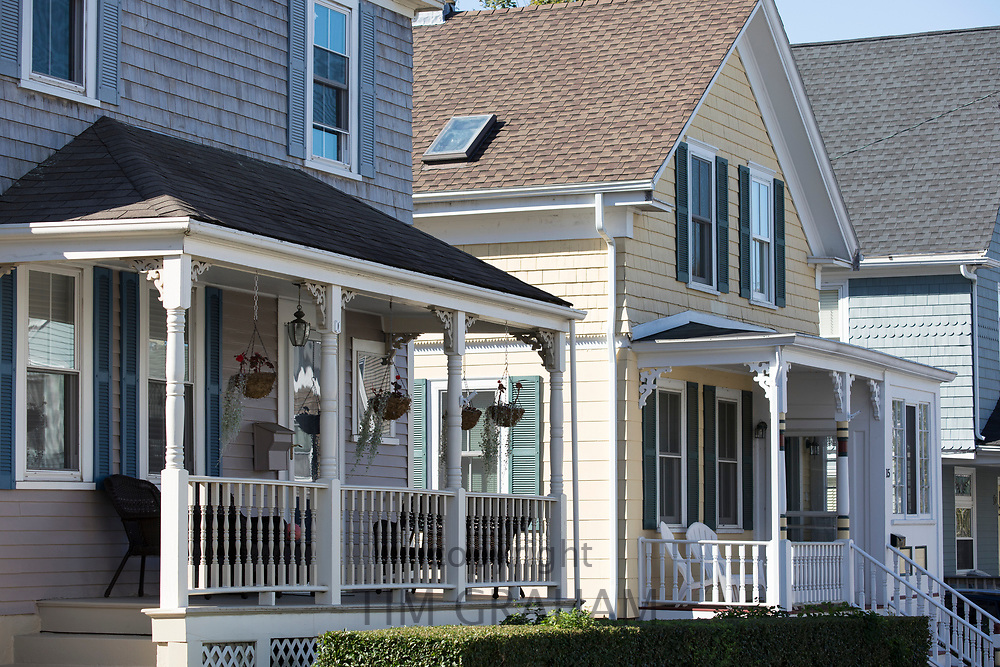 Typical traditional neat painted wood shingle houses with front stoop in Newport, Rhode Island, USA