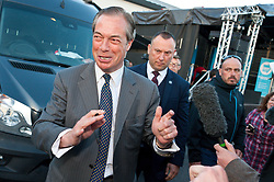 © Licensed to London News Pictures. 15/05/2019. Merthyr Tydfil, Powys, Wales, UK. Nigel farage is surrounded by the press and Brexiteers. An outdoor Brexit Party rally takes place at Trago Mills in the Welsh, former mining town, of Merthyr Tydfil in Powys, UK. The Brexit Party was founded by former UKIP economics spokeswoman, Catherine Blaiklock in January 2019 to support the winning Brexit vote in the 'Leave or Remain' referendum of 23rd June 2016. Brexit Party members point out that the UK prime minister, Theresa May, has betrayed her electorate by not keeping her pledge that the UK would leave the European Union on March 29th 2019, the date set by invoking article 50 of the Treaty of Lisbon. Photo credit: Graham M. Lawrence/LNP