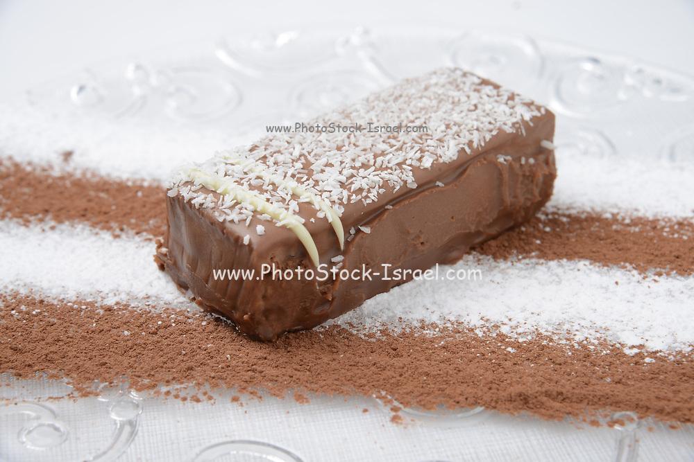 Chocolate cream cake garnished with coconut shavings