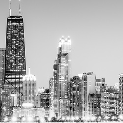 Streeterville North Chicago skyline panorama picture in black and white with the John Hancock Center building and other buildings along Chicago's Gold Coast. The John Hancock Center is one of the world's tallest skyscrapers and is a famous fixture in the Chicago skyline. Panorama photo ratio is 1:3. Image Copyright © 2012 Paul Velgos with All Rights Reserved.