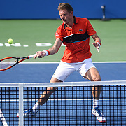NICOLAS MAHUT approaches the net during his second round match at the Citi Open at the Rock Creek Park Tennis Center in Washington, D.C.