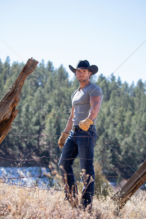 All American hot cowboy working on a ranch
