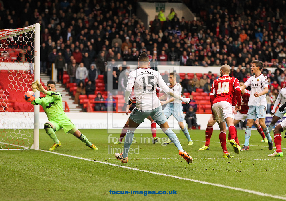 Picture by Tom Smith/Focus Images Ltd 07545141164<br /> 05/01/2014<br /> Ravel Morrison (centre) of West Ham United takes a shot at goal during the The FA Cup match at the City Ground, Nottingham.