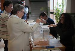 April 28, 2019 - Malaga, Spain - An elderly woman is seen casting her vote at a polling station during the general elections in Spain..The vote of this 28 April in Spain marked by the growth of Spanish radical right wing party VOX lead by his main candidate Santiago Abascal, and its possible entrance into the Spanish government with a high number of seats according to the latest polls, would suppose a hard blow for traditional left parties. Around 37 million Spaniards are called to cast their ballots in this general elections in a context of uncertain and political crisis in decades, which will determine the future course of the Spanish politics and possible electoral agreements between parties for the next Spanish government. (Credit Image: © Jesus Merida/SOPA Images via ZUMA Wire)