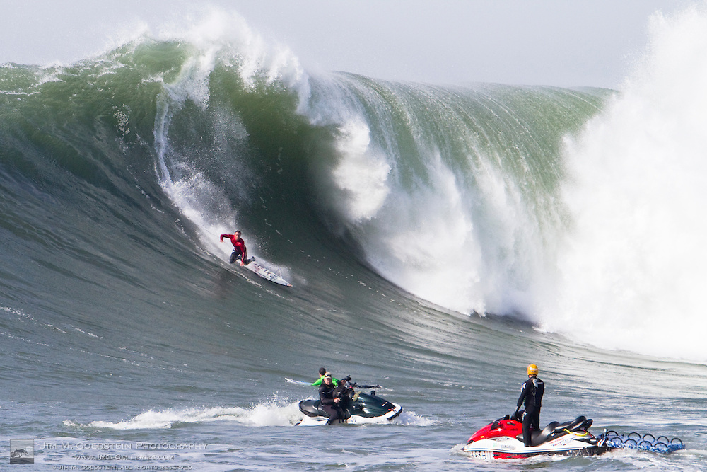 Anthony Tashnik, third place finisher at the 2010 Mavericks Surf Contest, wipes out on a giant wave during the finals - Half Moon Bay, California - February 13, 2010