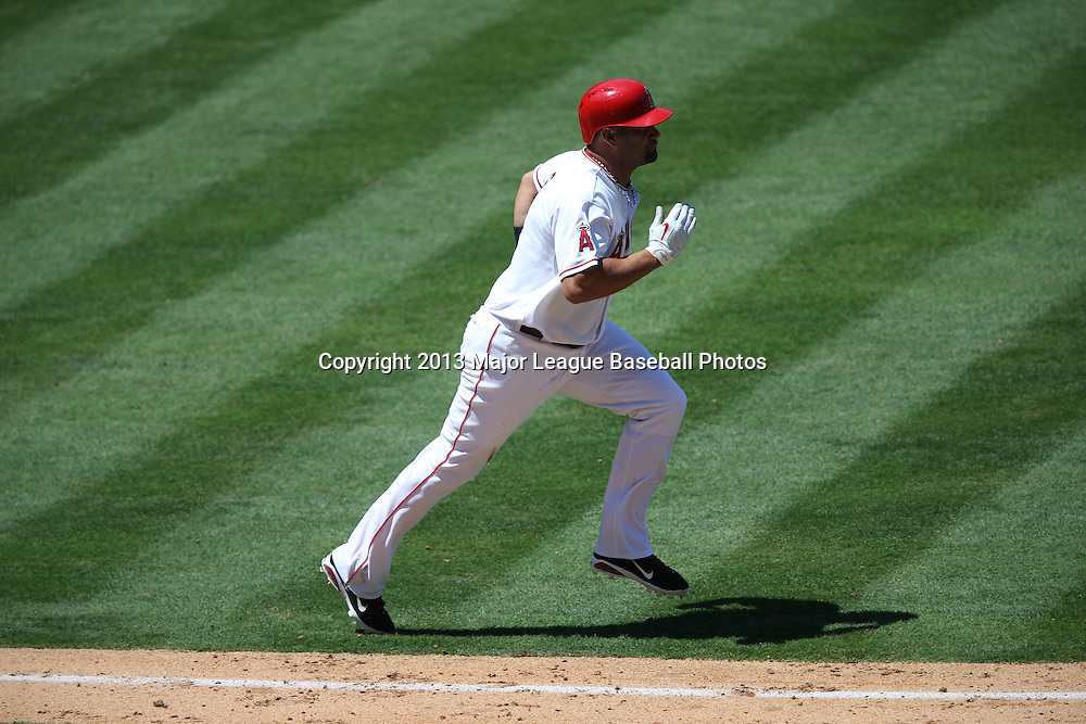 ANAHEIM, CA - JULY 24:  Albert Pujols #5 of the Los Angeles Angels of Anaheim runs to first base as he grounds out in the bottom of the 6th inning during the game against the Minnesota Twins on Wednesday, July 24, 2013 at Angel Stadium in Anaheim, California. The Angels won the game in a 1-0 shutout. (Photo by Paul Spinelli/MLB Photos via Getty Images) *** Local Caption *** Albert Pujols