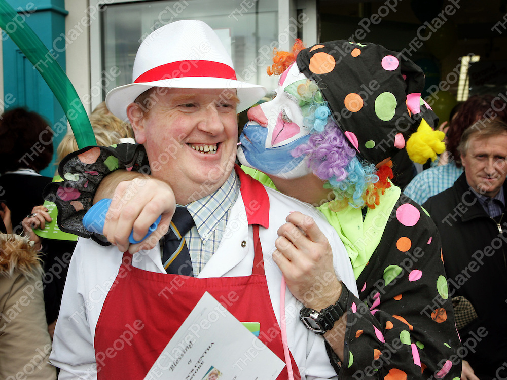 08/11/06<br />Store Butcher, Eddie O'Loughlin gets a peck on the cheek from Mr. Babycheeks at the official opening of the new Ryans Centra Store in Clonroadmore, Ennis on Wednesday.<br />Pic: Don Moloney / Press 22