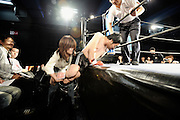 A wrestler gets a helping hand into the ring prior to a bout at Doglegs, an event for wrestlers with physical and mental handicaps in Tokyo, Japan.