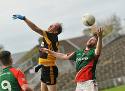 Lahardane Gary Naughton and Kilmaine's Frank Burke contest a high ball during the County junior final.<br /> Pic Conor McKeown
