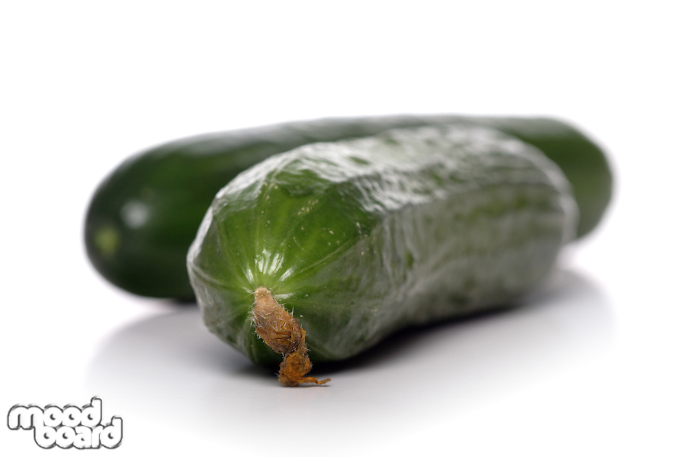 Two cucumbers on white plate