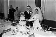 05/07/1967<br /> 07/05/1967<br /> 05 July 1967<br /> Wedding of George Walsh, eldest son of Mr and Ms Kevin G. Walsh, St. Rita's, Firhouse Road, Templeogue, Co. Dublin and Miss Arlene McMahon, elder daughter of Det. Chief Supt. Philip McMahon, Head of Special Branch, Dublin Castle and Mrs McMahon of Lisieux, Templeville Park, Templeogue, Co. Dublin who were married at the Carmelite Church, Terenure College, Dublin. An Taoiseach Mr Jack Lynch and Mrs Lynch; Mr Liam Cosgrave, leader Fine Gael and Mrs Cosgrave were among the 120 guests. Rev Fr H.E. Wright, O. Carm., Moate, officiated at the ceremony. The reception was held at Downshire Hotel, Blessington, Co. Wicklow. Picture shows the couple cutting the wedding cake at the reception.