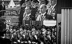 Russian soldiers stand near the huge banner with portrait of Russian President Dmitry Medvedev and Prime Minister Vladimir Putin during the rehearsal of the military parade which will take place on the Red Square on 09 May, devoted to the victory of the Soviet Union over Nazi Germany in the WWII,  in the village of Alabino outside Moscow, Russia, 18 April 2012. The parade will include the demonstration of the heavy military technics and aviation.