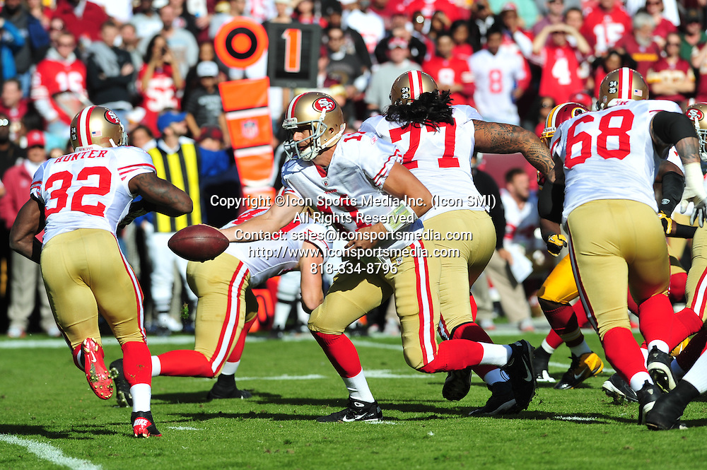 Nov. 06, 2011 - Landover, Maryland, United States of America - NFL game action in Landover Md; San Francisco 49ers quarterback Alex Smith (11) with handoff to running back Kendall Hunter (32).The 49ers defeat the Redskins at home 19 -11