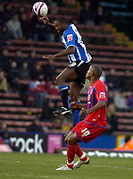 Photo: Matt Bright/Sportsbeat Images.<br /> Crystal Palace v Sheffield Wednesday. Coca Cola Championship. 15/12/2007.<br /> Francis Jeffers of Sheffield Wednesday heads clear of Clinton Morrison of Crystal Palace