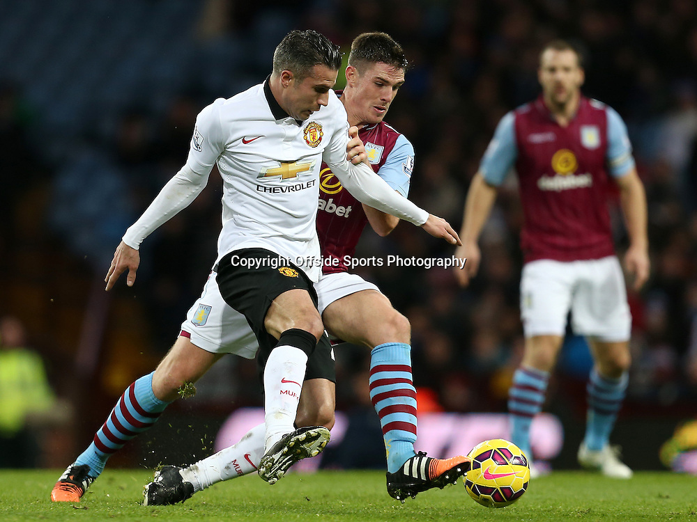 20th December 2014 - Barclays Premier League - Aston Villa v Manchester United - Robin Van Persie of Manchester United battles for a loose ball with Ciaran Clarke of Aston Villa - Photo: Paul Roberts / Offside.