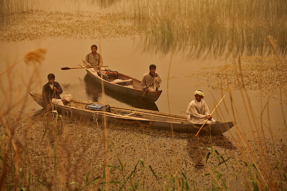 Iraqi Marshland Arab fishermen in on the marsh in Maysan Province as a dust storm aproached