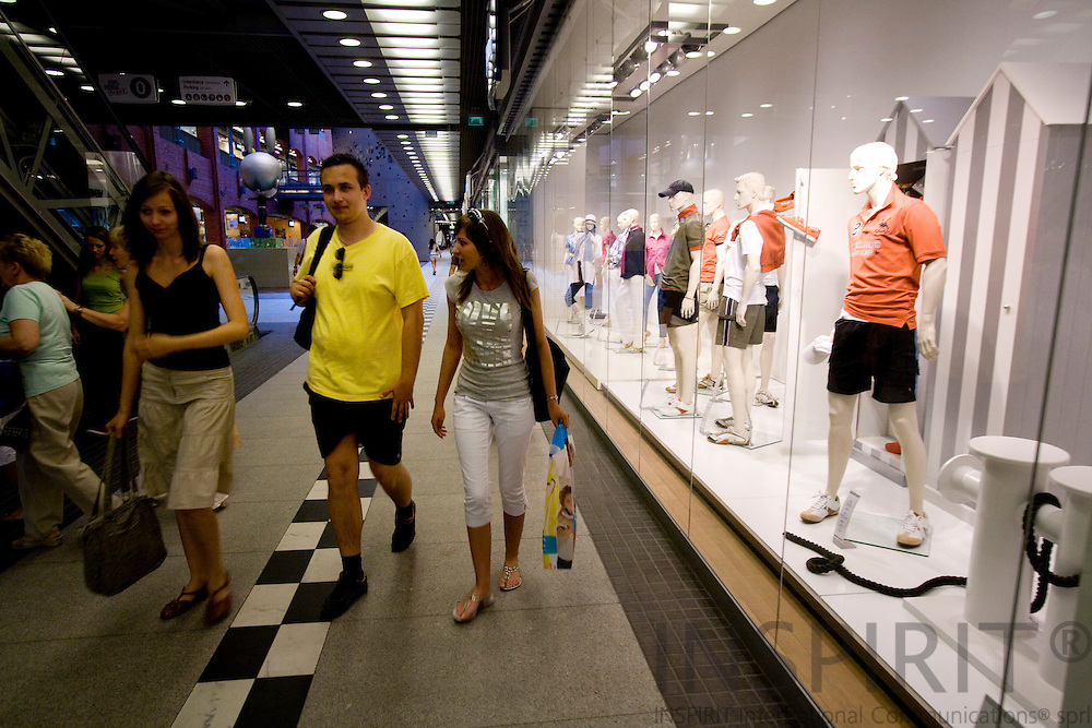 POZNAN - POLAND - 3 JUNE 2008 -- Shoppers passing a  shop window with mens summer dress in the newly renovated Stary Browar (the Old Brewery). It is counted as one of the best shopping centres in the world. It also contains restaurants and bars. Photo: Erik Luntang/INSPIRIT Photo