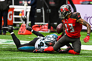 Carolina Panthers Defensive Back James Bradberry (24) tackles Tampa Bay Buccaneers Wide Receiver Mike Evans (13) forcing a fumble during the International Series match between Tampa Bay Buccaneers and Carolina Panthers at Tottenham Hotspur Stadium, London, United Kingdom on 13 October 2019.