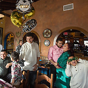 FAIRFAX, VA -DEC21: Emerita Ayala, 23, celebrates her graduation from George Mason University, at Guapos restaurant, December 21, 2016, in Fairfax, Virginia. Emerita started as a teenage mom at 18, with her 3-year-old son at community college. She got help through a nonprofit called Generation Hope that provides scholarships and mentoring to teenage moms. (Photo by Evelyn Hockstein/For The Washington Post)