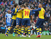 Arsenal players celebrate Arsenal's Theo Walcott goal during the The FA Cup match between Brighton and Hove Albion and Arsenal at the American Express Community Stadium, Brighton and Hove, England on 25 January 2015. Photo by Phil Duncan.