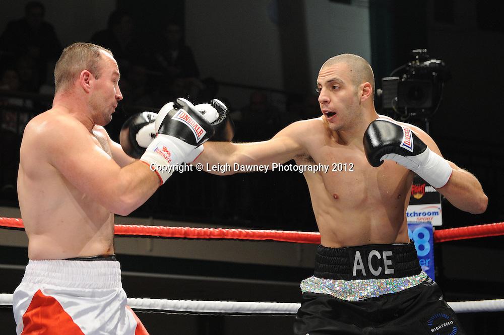 Andreas Evangelou (black shorts)  defeats Robert Studzinski in a 4x3min Light Heavyweight contest at York Hall, Bethnal Green, London on 28th January 2012.Matchroom Sport. © Leigh Dawney Photography 2012.