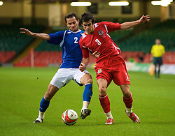 CARDIFF, WALES - Friday, September 5, 2008: Wales' Gareth Bale and Azerbaijan's goalkeeper Kamran Agayev during the opening 2010 FIFA World Cup South Africa Qualifying Group 4 match at the Millennium Stadium. (Photo by David Rawcliffe/Propaganda)