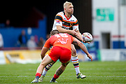 Bradford Bulls loose forward Damian Sironen (10) passes the ball during the Kingstone Press Championship match between Sheffield Eagles and Bradford Bulls at, The Beaumont Legal Stadium, Wakefield, United Kingdom on 3 September 2017. Photo by Simon Davies.