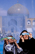 ..Esfahan, IRAN..Women in Imam Square looking to the skies during the solar eclipse of August 1999