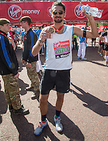 PR and reality TV star Hugo Taylor (Made in Chelsea) at the end of the Virgin Money London Marathon 2014 on Sunday 13 April 2014<br /> Photo: Roger Allan/Virgin Money London Marathon<br /> media@london-marathon.co.uk