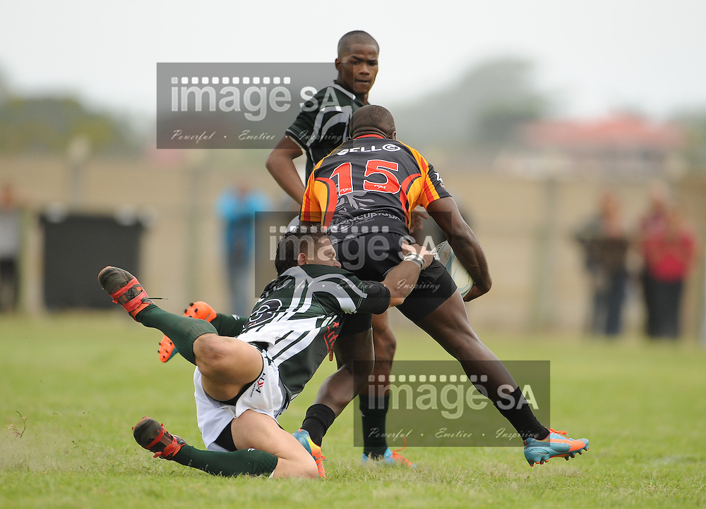 GEORGE, SOUTH AFRICA - Saturday 7 March 2015, Deroy Rhoode of Pacaltsdorp Evergreens chases Menzi Ngidi of Vaseline Wanderers during the third round match of the Cell C Community Cup between Pacaltsdorp Evergreens and Vaseline Wanderers at Pacaltsdorp Sports Grounds, George<br /> Photo by Roger Sedres/ImageSA/ SARU