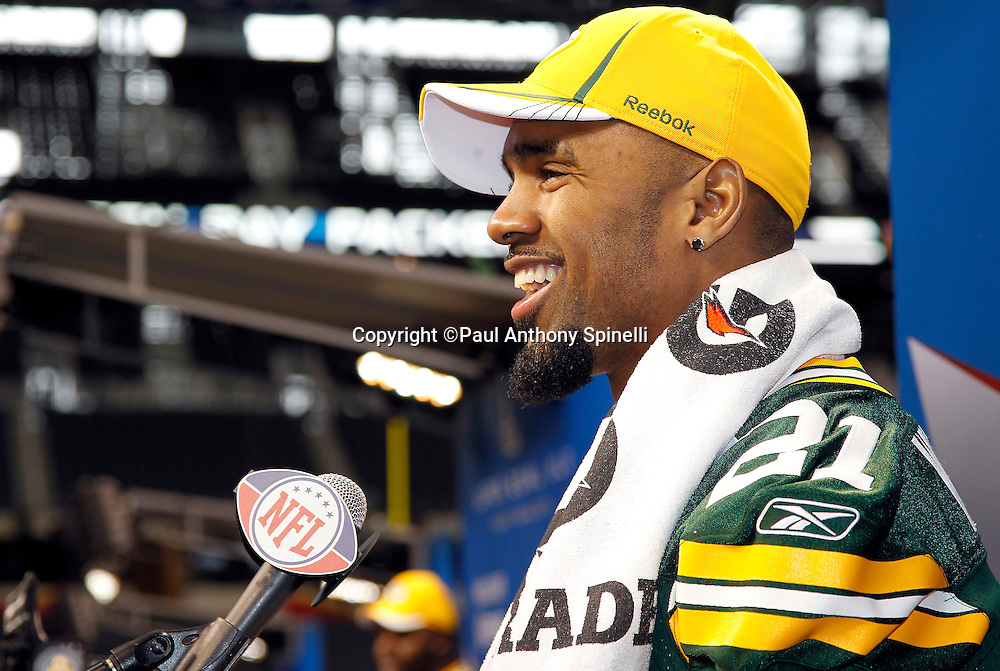 Green Bay Packers cornerback Charles Woodson (21) laughs as he speaks to the press at Super Bowl XLV media day prior to NFL Super Bowl XLV against the Pittsburgh Steelers. Media day was held on Tuesday, February 1, 2011 in Arlington, Texas. ©Paul Anthony Spinelli