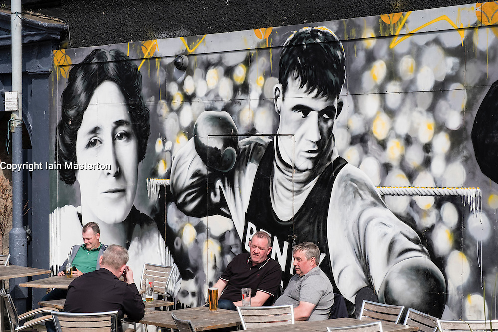 Men drinking outside Clutha pub in Glasgow united Kingdom