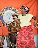 Hamptonburgh, New York - A member of the Sankofa Drum and Dance Ensemble performs at the fourth annual Earth & Water Festival at Thomas Bull Memorial Park on June 4, 2011.