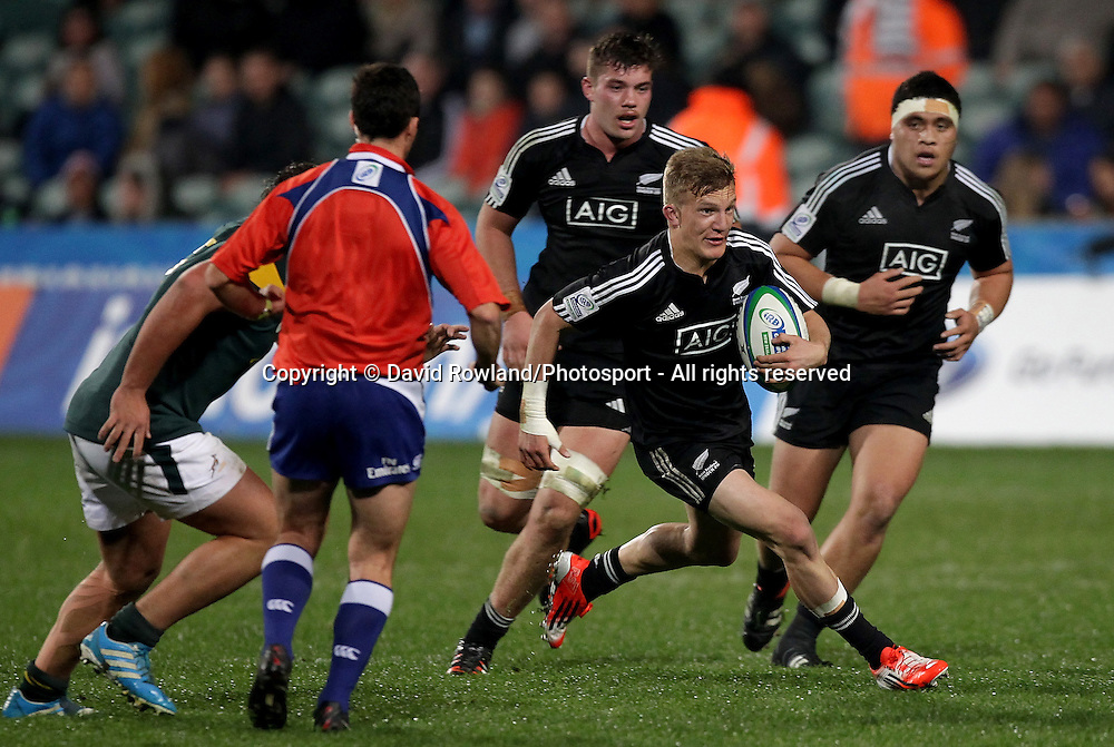 New Zealand's Damian McKenzie makes a break in the New Zealand v South Africa. IRB Junior World Championships Semi Final. Rugby Union. North Harbour Stadium, Auckland, New Zealand., Sunday, June 15, 2014. Photo: David Rowland/Photosport