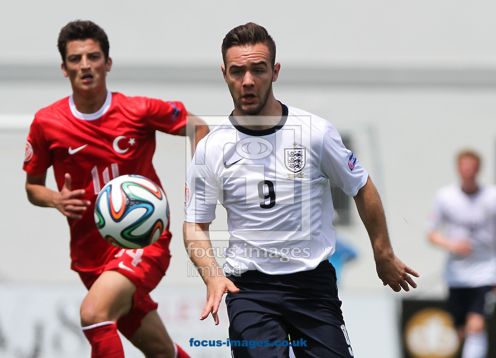 Adam Armstrong (centre) of England chases down the ball during the 2014 UEFA European Under-17 match at Gozo Stadium, Xewkija<br /> Picture by Tom Smith/Focus Images Ltd 07545141164<br /> 12/05/2014