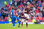 Oliver Bozanic (#7) of Heart of Midlothian FC wins a header during the William Hill Scottish Cup semi-final match between Heart of Midlothian and Inverness CT at Hampden Park, Glasgow, United Kingdom on 13 April 2019.