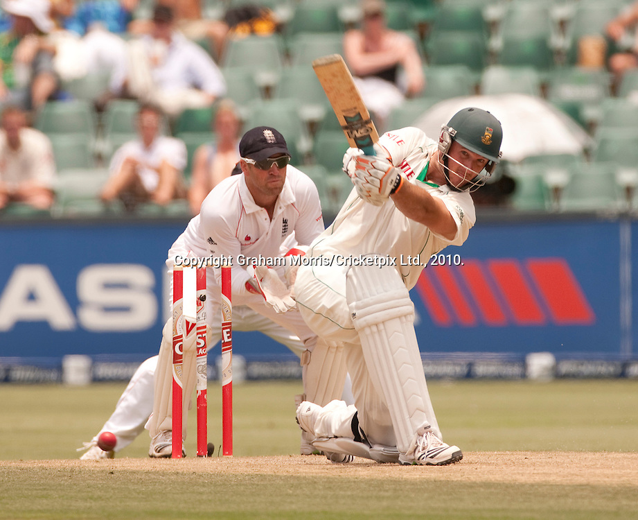 Graeme Smith drives Graeme Swann for four during the fourth and final Test Match between South Africa and England at the Wanderers Stadium, Johannesburg. Photograph © Graham Morris/cricketpix.com (Tel: +44 (0)20 8969 4192; Email: sales@cricketpix.com)
