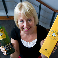 The Edrington Group Packaging Team....29.09.10<br /> Linda Macaulay with a bottle of Cutty Sark Whisky<br /> Picture by Graeme Hart.<br /> Copyright Perthshire Picture Agency<br /> Tel: 01738 623350  Mobile: 07990 594431