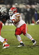 Kansas City Chiefs nose tackle Dontari Poe (92) works his way around a block by Oakland Raiders guard Austin Howard (77) during the NFL week 12 regular season football game against the Oakland Raiders on Thursday, Nov. 20, 2014 in Oakland, Calif. The Raiders won their first game of the season 24-20. ©Paul Anthony Spinelli